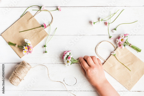 Workspace With Small Bouquets Of Daisy Flowers Paper Bags Creation