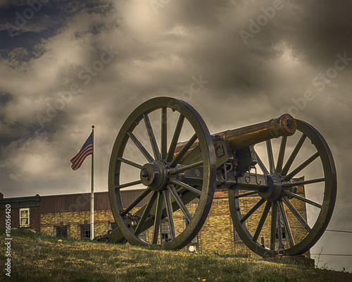 Fotografie, Obraz  Cannon with American flag in background