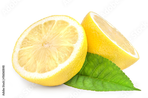 Lemon wedges with leaves on white Fototapeta