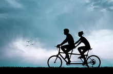 Couple Silhouette In Tandem