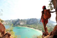 Young Woman Backpacker Hiking On Seaside