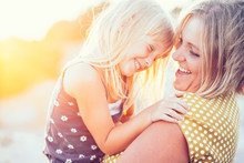 Mom Playing With Child In Sunlight