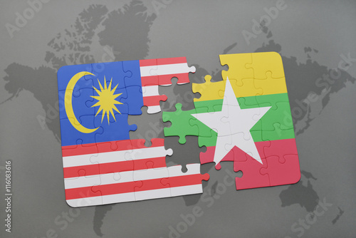 puzzle with the national flag of malaysia and myanmar on a world map background Poster