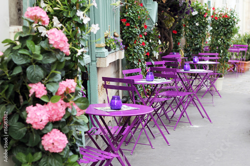 Paris street cafe with bright tables. © 3azigalka