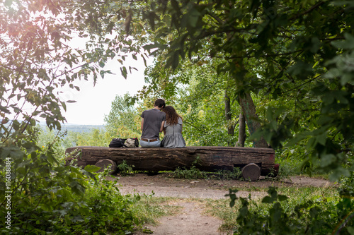 Couple On A Bench Two Lovers Sitting On A Bench In A Park In The