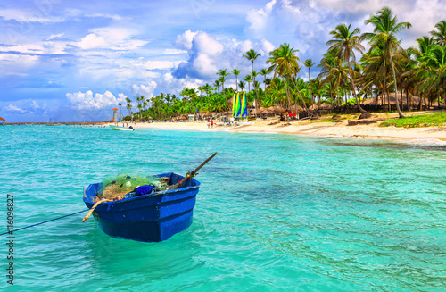 plakat Fishing boat at the sea coast of the Dominican Republic. Blue fishing boat.