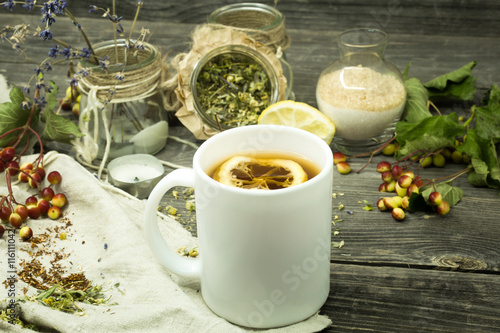 Staande foto Thee Cup of tea on wooden background with lemon and herbs