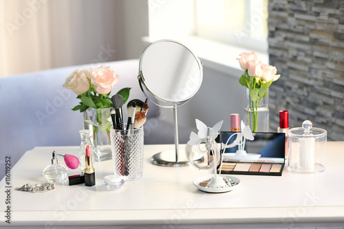 Photo Cosmetic set on light dressing table