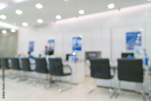 Fototapeta blur bank officer working with computer on business and finance obraz