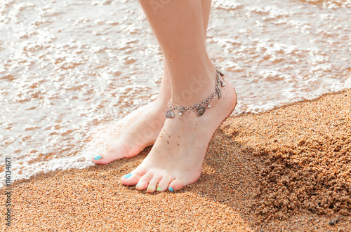 legs of a young girl and anklet ankle Canvas Print