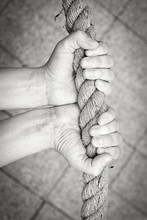Black And White Image Of Hands Holding The Rope