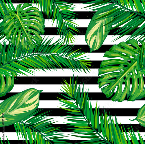 Stampa su Tela Beautiful seamless tropical jungle floral pattern background with palm leaves