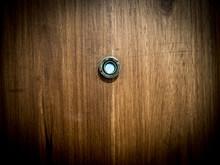 Door Lens Peephole On Wood Texture