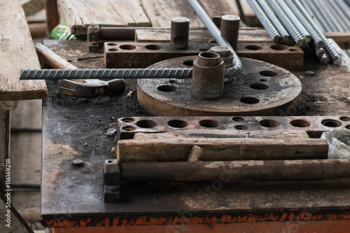 Specialist using steel bending machine rebar for building equipment Lerretsbilde