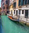 Gondola, old buildings and bridge in central Venice