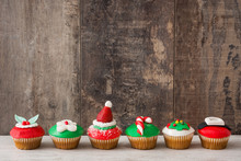 Christmas Cupcakes On Wooden Background