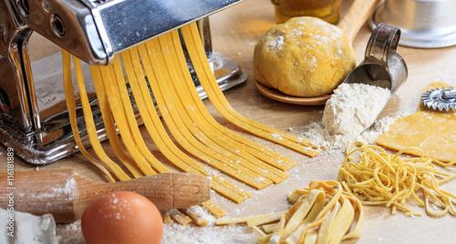 Fotografie, Obraz  Fresh tagliatelle pasta homemade preparation