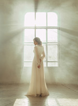Lady In White Vintage Dress Standing In A Large Spacious Room , Fantastic Shot, Fairytale Princess Turned Into Smoke , Trendy Toning , Creative Computer Colors.