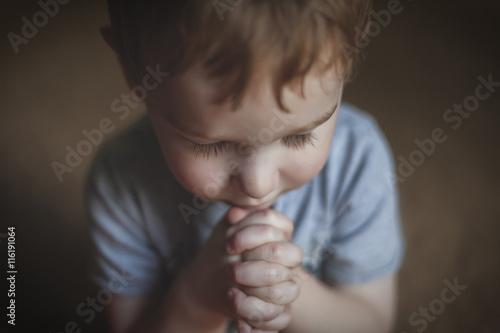 Fotografie, Obraz  Cute Young Boy Praying