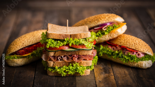 Tuinposter Snack Sandwiches with ham and cheese on the table