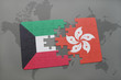puzzle with the national flag of kuwait and hong kong on a world map background.