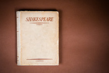 A Book By Shakespeare On Vintage Background