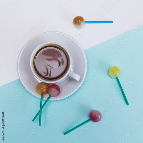 Fotografie, Tablou  Cup of cacao and sweets on blue and white background