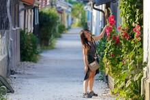 Woman Showing Hollyhock Flowers
