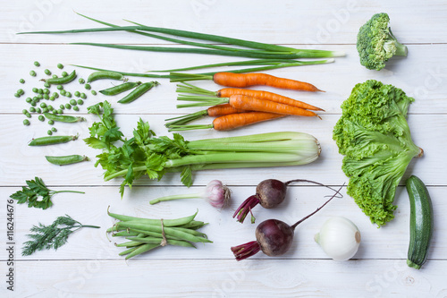 Valokuva  Collection of fresh summer vegetables on white rustic background