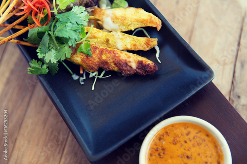 Fotografering  close up of deep-fried asian snacks on plate