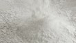 Scattered dry flour on a kitchen counter top