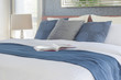 Book on bed with blue color scheme bedding bedroom interior