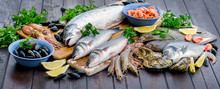 Raw Seafood On A Wooden Table.