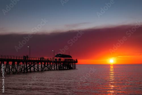 fototapeta na lodówkę People on jetty at sunset
