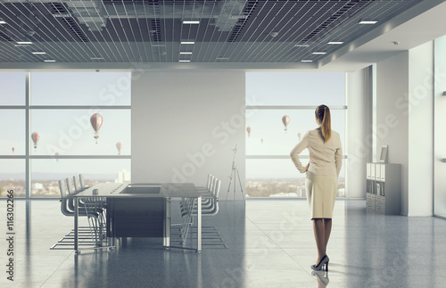 Fototapety, obrazy: Businesswoman in modern office interior   . Mixed media