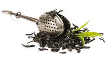 Tea Strainer And Leaves Of Tea.