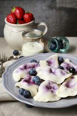 Fototapeta Do gastronomi Dumplings with blueberries