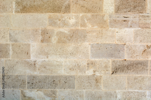 Photo  gray wall of sandstone blocks of rectangular shape with smooth edges