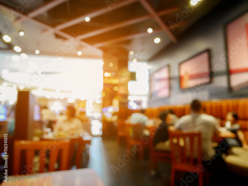 Poster Restaurant Customer in restaurant blur background with bokeh