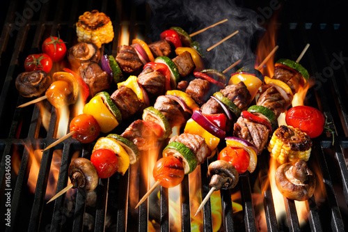 Aluminium Prints Grill / Barbecue Meat kebabs with vegetables on flaming grill