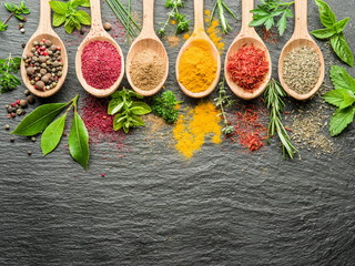 Fototapeta Assortment of colorful spices in the wooden spoons.
