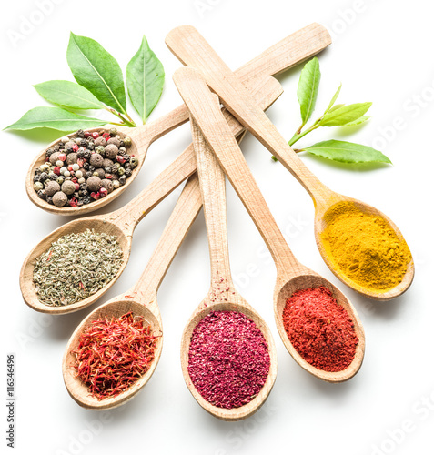 Canvas Prints Spices Assortment of colorful spices in the wooden spoons on the white