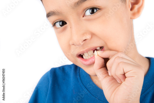 Little boy showing baby teeth toothless close up waiting for new teeth Poster