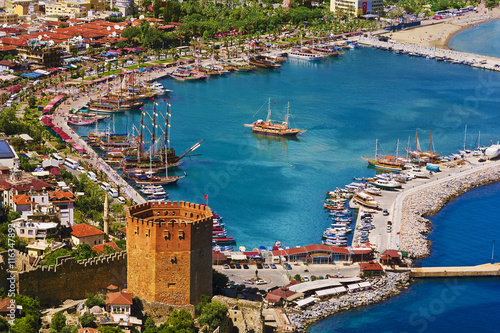 Fotobehang Turkije Turkey. Alanya. Aerial view from the Citadel of Alanya on the Red Tower (Kizil Kule) and marina