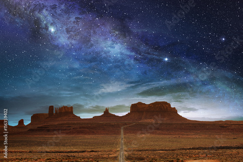 scenic route to the monument valley under a night starry sky