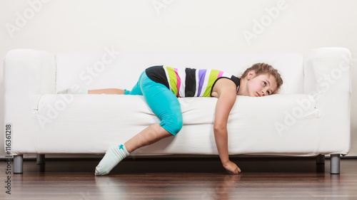 Fotografie, Obraz  Tired exhausted lazy little girl kid lying on sofa