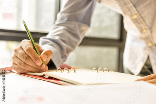 Fototapeta businessman hand working with new laptop and writing on the note obraz