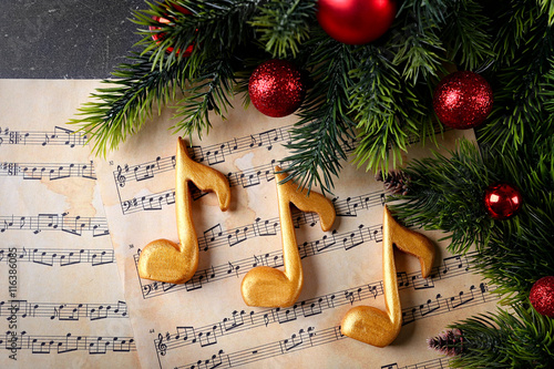 Fototapeta  Christmas decorations on music sheets