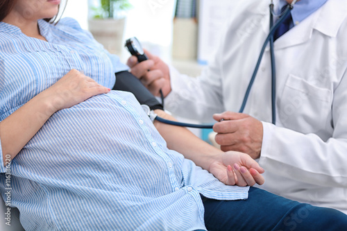 Fotografie, Obraz  Doctor measuring pressure of the pregnant woman