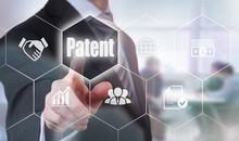 A Businessman Selecting A Patent Concept Button On A Hexagonal Screen